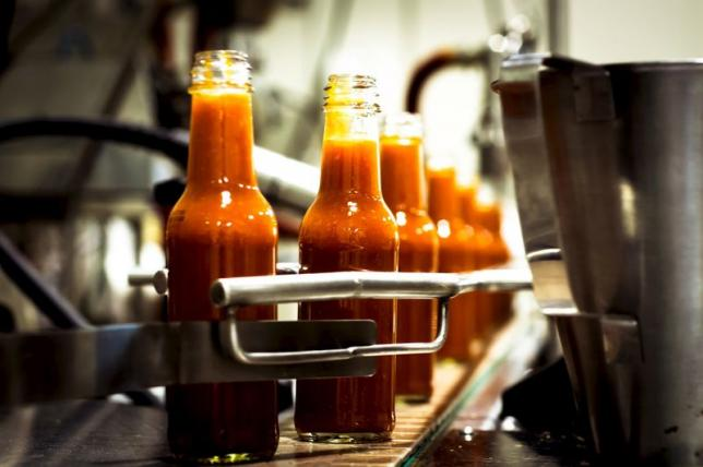 Bottles are filled along a production line at the factory of hot sauce company Culley's in Auckland, New Zealand in this 2014 handout photo obtained by Reuters April 24, 2015. REUTERS/Culley's/Handout via Reuters